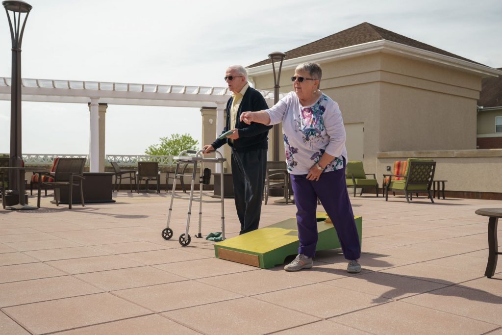 residents playing cornhole